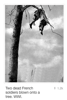 Image of two French soldiers blown into a tree by artillery